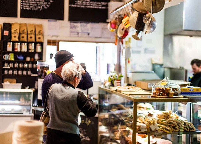 Happy people at the Deli