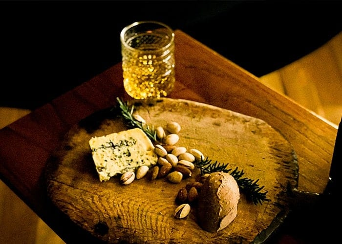 Cognac by the fire with cheese, pate and nuts
